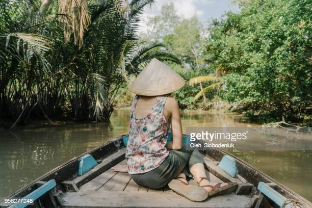 woman riding on boat through mekong delta - hot women on boats stock pictures, royalty-free photos & images