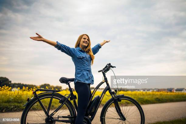 Woman riding on her Electric Bike