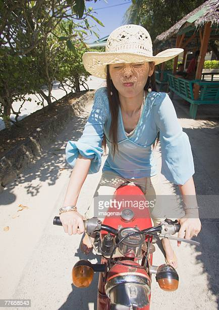 Woman riding on motorcycle