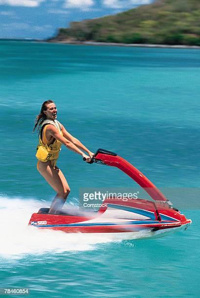 Woman riding personal watercraft
