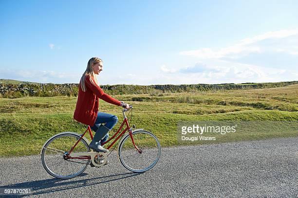 Woman riding retro bike.