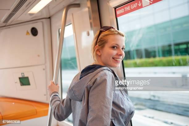 Woman riding shuttle bus