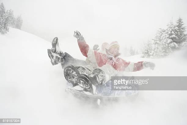 woman riding snow tube - laborschlauch stock-fotos und bilder