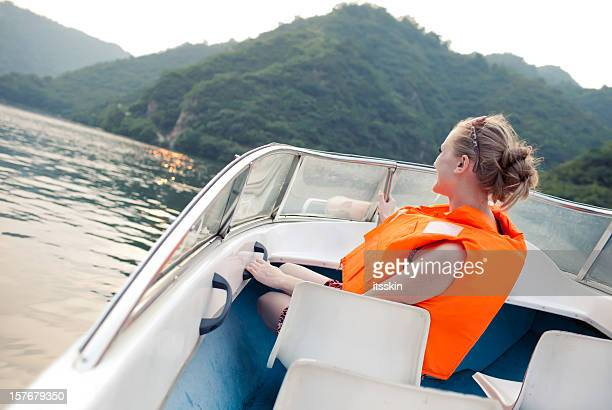 Woman riding the boat