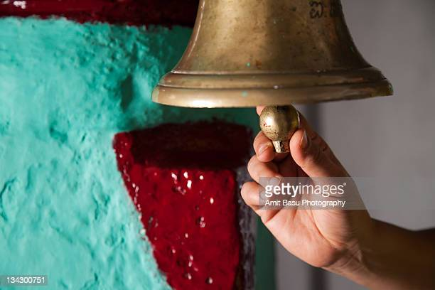 Woman ringing bell