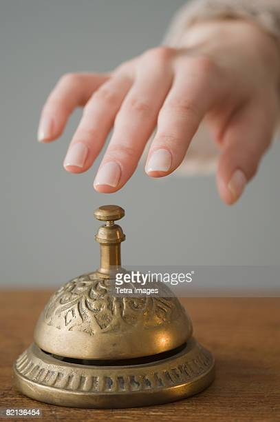 Woman ringing service bell