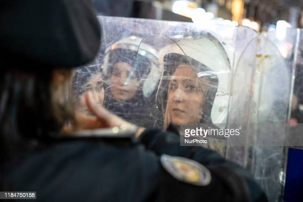 A woman riot police officer stands during the International Day for the Elimination of Violence against Women rally at Beyoglu district of Istanbul...