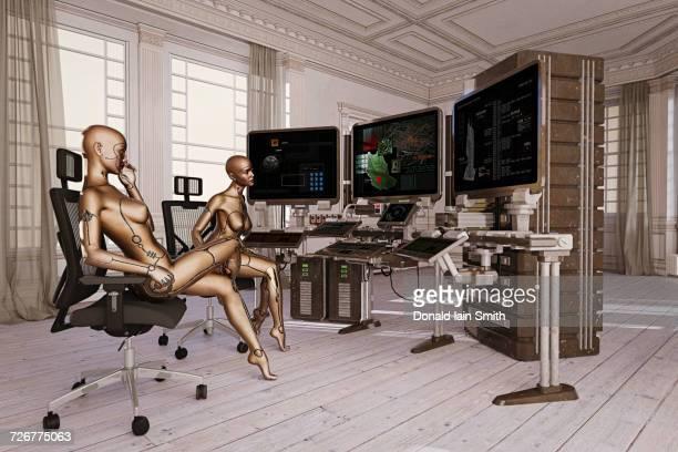 Woman robots watching computer monitors