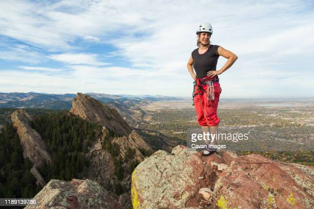 woman rock climber on summit of third flatiron, boulder, colorado - front range mountain range stock pictures, royalty-free photos & images
