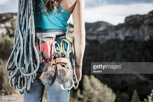 Woman rock climber with equipment