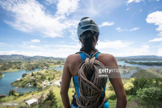 woman rock climbing and looking at the beautiful view - guatapé stock pictures, royalty-free photos & images