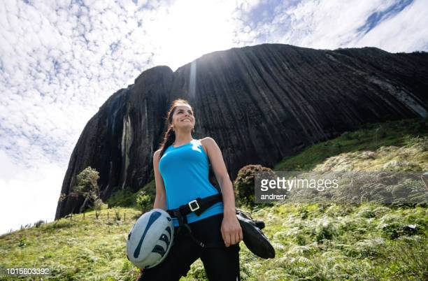 woman rock climbing at guatape in colombia - guatapé stock pictures, royalty-free photos & images