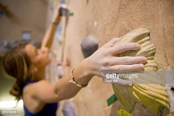 A woman rock climbing indoors at Estes Park, Colorado.