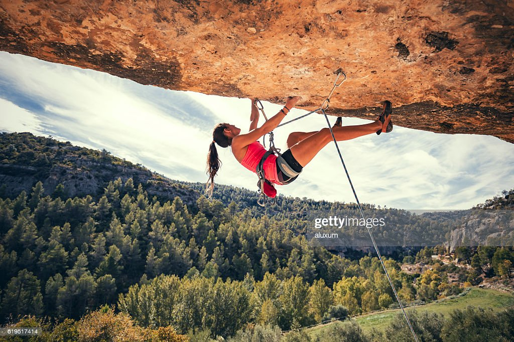 Woman rock climbing : Stock Photo