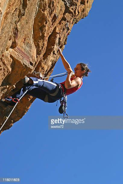 woman rockclimbing - rock overhang stock photos and pictures