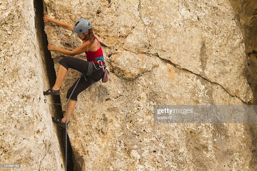Woman rockclimbing : Stock Photo