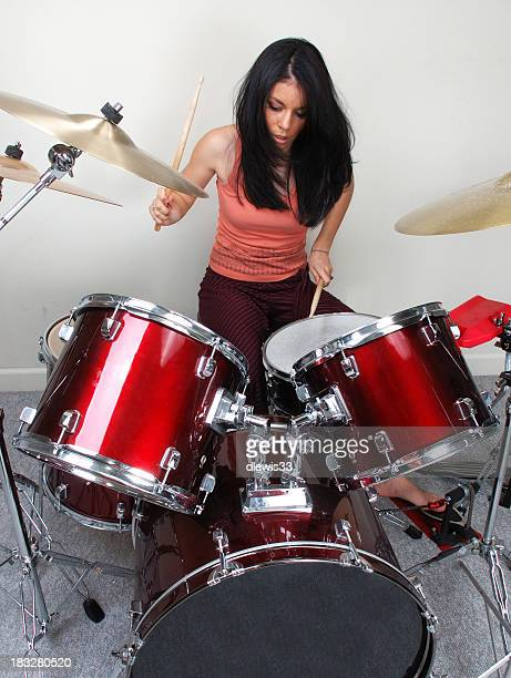 A woman rocking out on a drum set