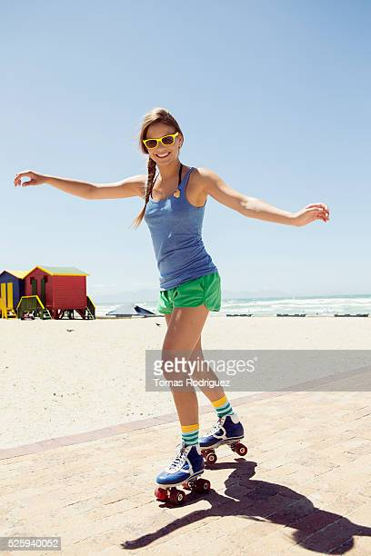 Woman roller skating on beach