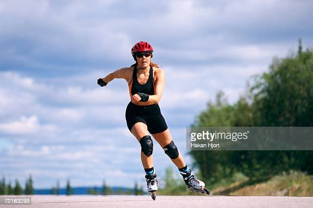 a woman rollerblading. - inline skate stock photos and pictures