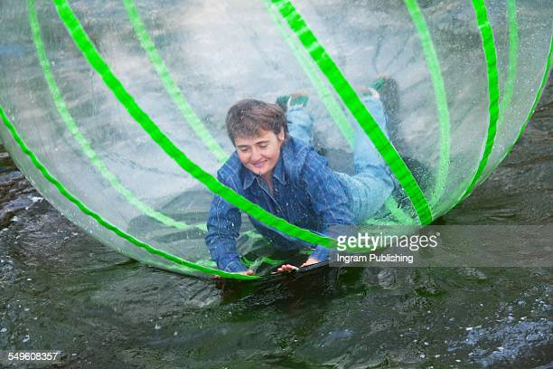 Woman rolling in zorb