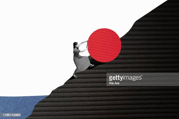 woman rolling object up hill - effort stock pictures, royalty-free photos & images