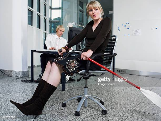 Woman rowing in office