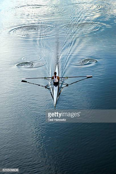 Woman rowing single scull.