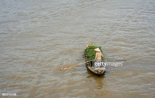 woman rowing with boat in the river - Floating market at Nga Nam Soc Trang