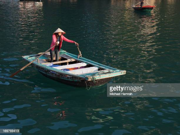 CONTENT] A woman rows a boat around the islands of Ha Long Bay outside of Vietnam These boats are the only mode of transport around the fishing...