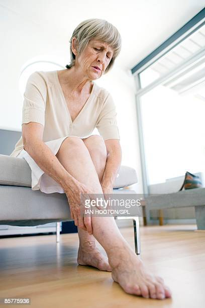 Woman rubbing aching leg