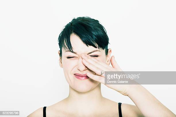 Woman Rubbing Eye