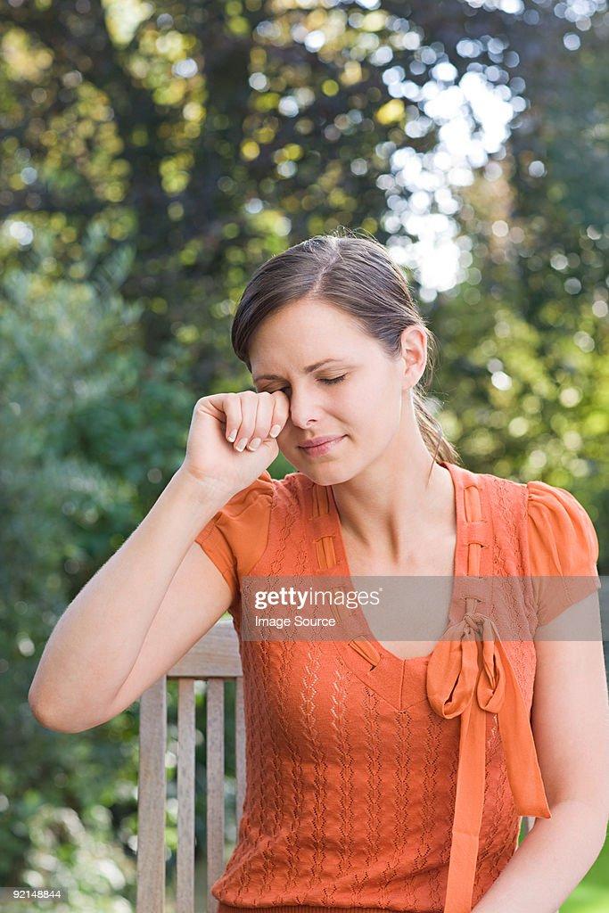 Woman rubbing eye : Stock Photo