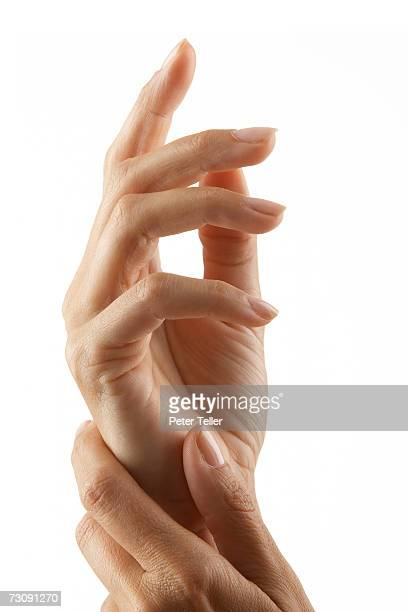 Woman rubbing hands, close up on hands, close-up