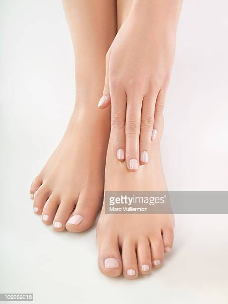 Woman rubbing her foot, close-up