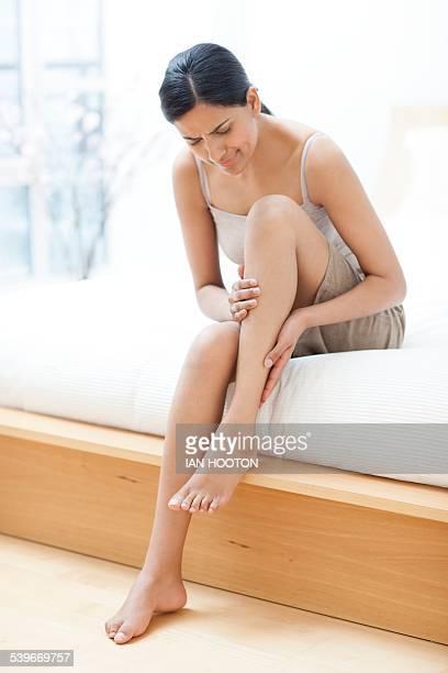 Woman rubbing her leg