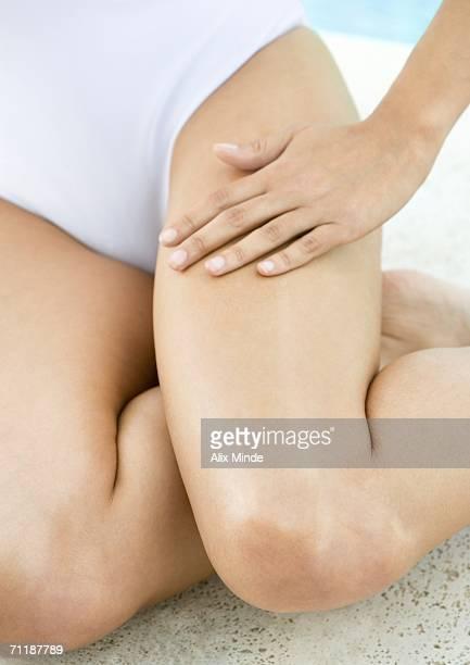 Woman rubbing leg