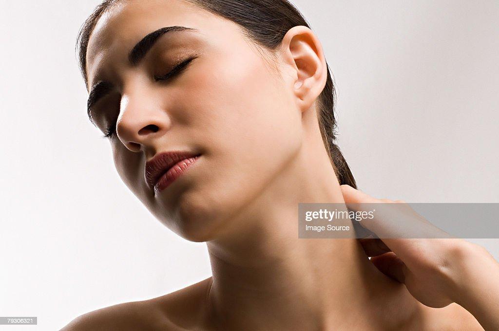 Woman rubbing neck : Stock Photo