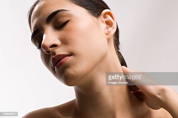 Woman rubbing neck