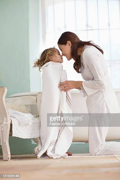 woman rubbing noses with her daughter wrapped in towel after the bath - wearing a towel stock pictures, royalty-free photos & images