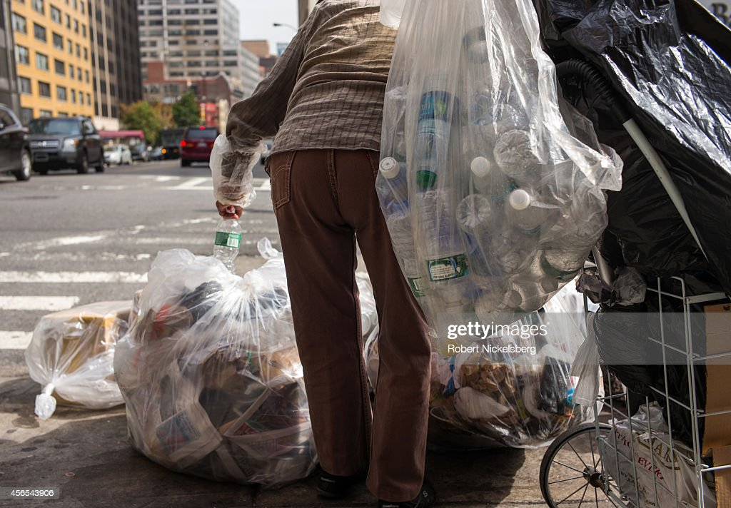 Woman Collects Refundable Bottles In Brooklyn : News Photo
