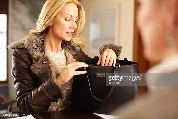 woman rummaging through purse - looking in bag stock pictures, royalty-free photos & images
