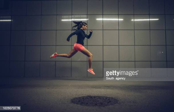 woman run and jump - long jump stock pictures, royalty-free photos & images