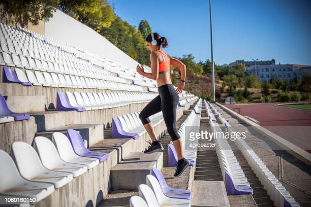 woman run up the stairs - scoring run stock pictures, royalty-free photos & images
