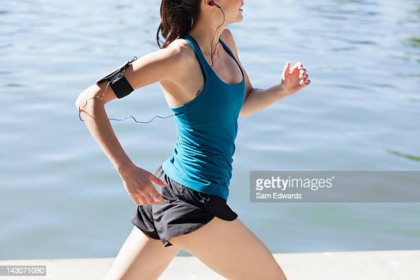 Woman running along lake