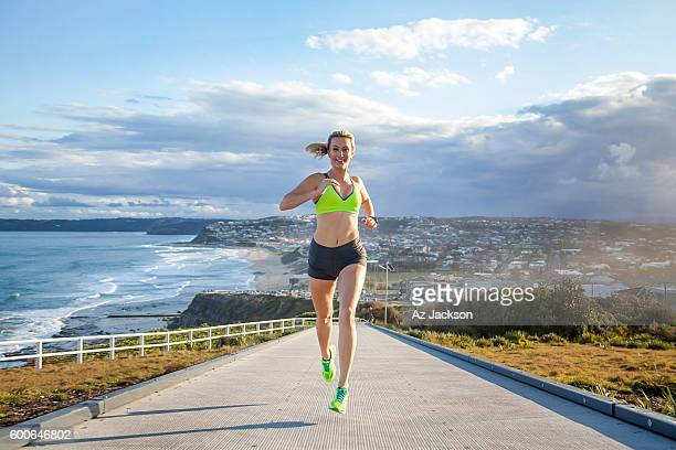 Woman running along the Anzac Bridge walkway