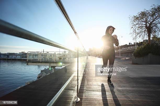 Woman running at morning in Genoa port