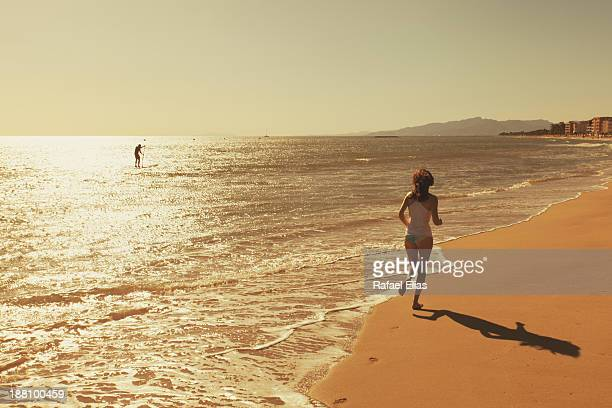 Woman running at sea shore