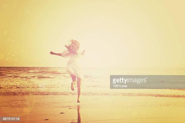 Woman running at seaside - circa 1950
