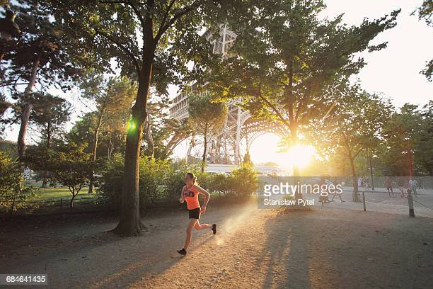 Woman running at sunset in Paris