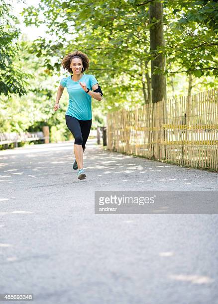 Woman running at the park trying to lose weight